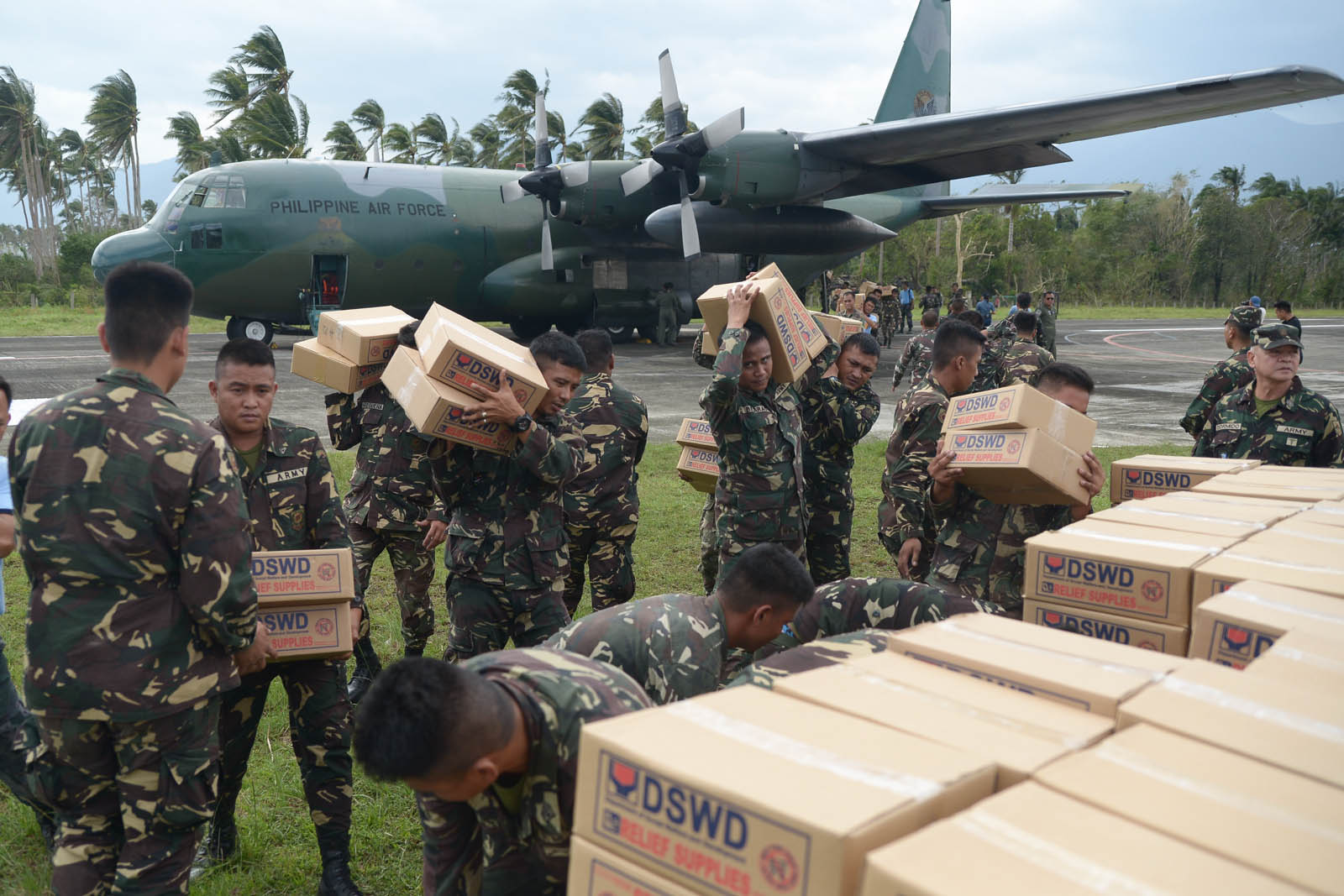 RELIEF GOODS. Members of the Philippine Air Force bring relief goods to Aurora province, after it was struck by Typhoon Lando in October 2015. Photo by Jansen Romero/Rappler