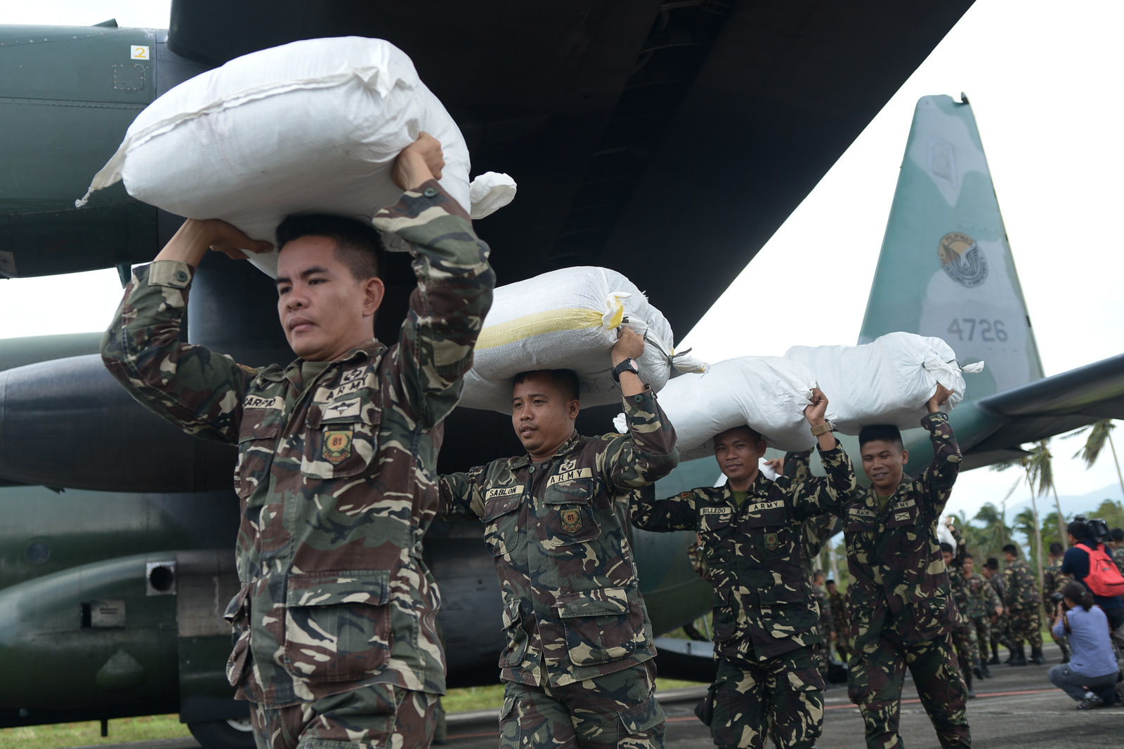 FOOD PACKS. Relief goods are unloaded from a C-130 plane in Baler, Aurora. Photo by Jansen Romero/Rappler