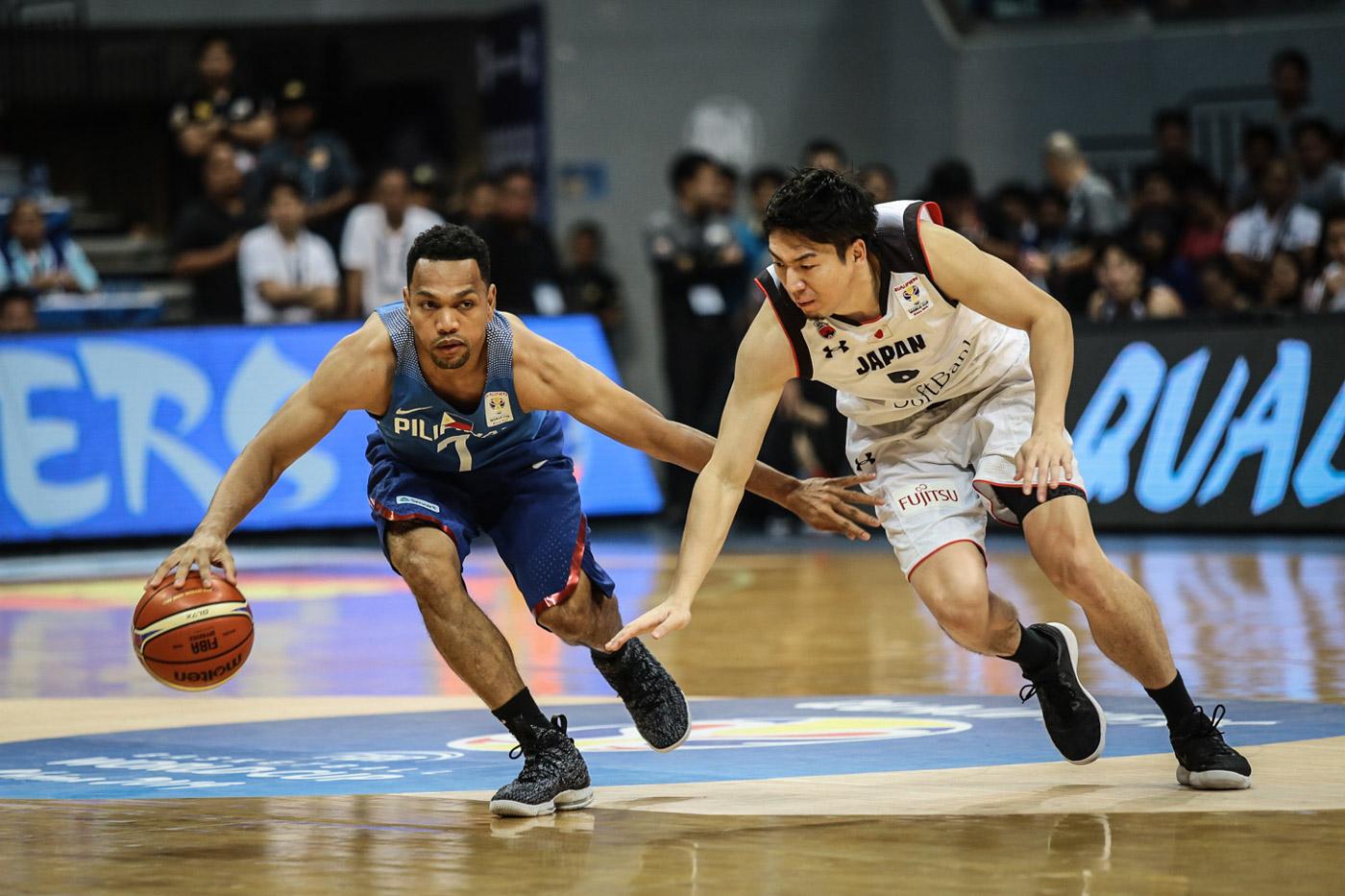 INSURANCE. Jason Castro easily avoids a Japanese defender.  Photo by Josh Albelda/Rappler