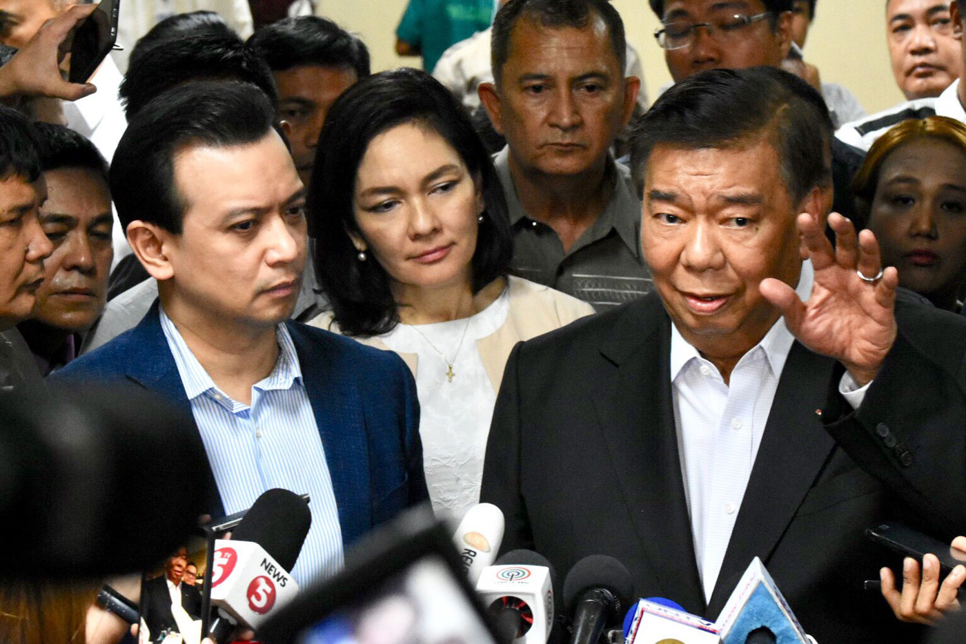 AMNESTY REVOKED. Senator Antonio Trillanes IV (L) faces the media regarding the arrest order on him following the revocation of his amnesty. Senate President Vicente Sotto III did not allow the arrest of Trillanes inside the Senate premises. Photo by Angie de Silva/Rappler