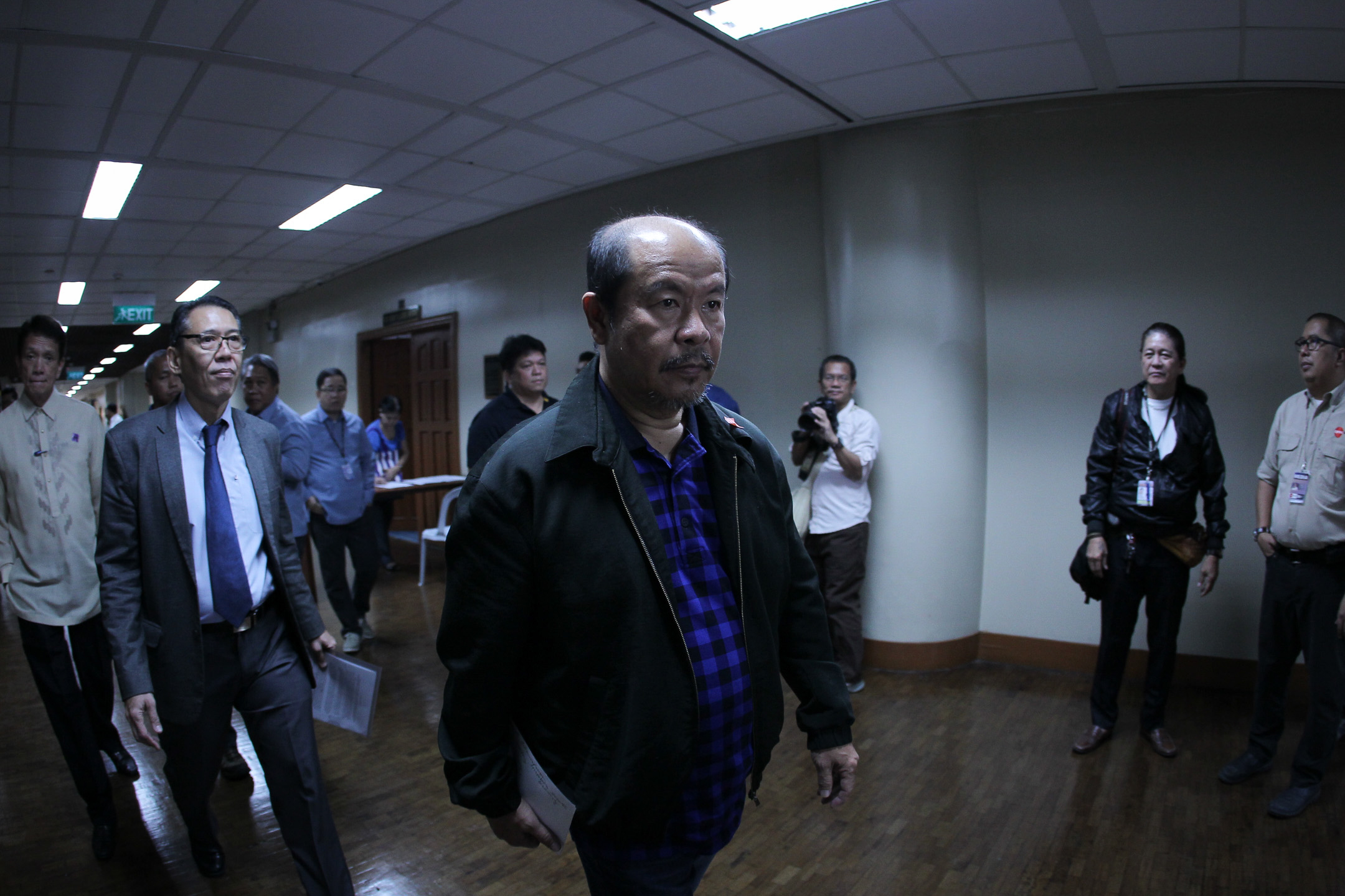 FLAG LAWYERS. Veteran human rights lawyers walk behind retired policeman Arturo Lascau00f1as before their press conference on Monday, February 17, 2017.