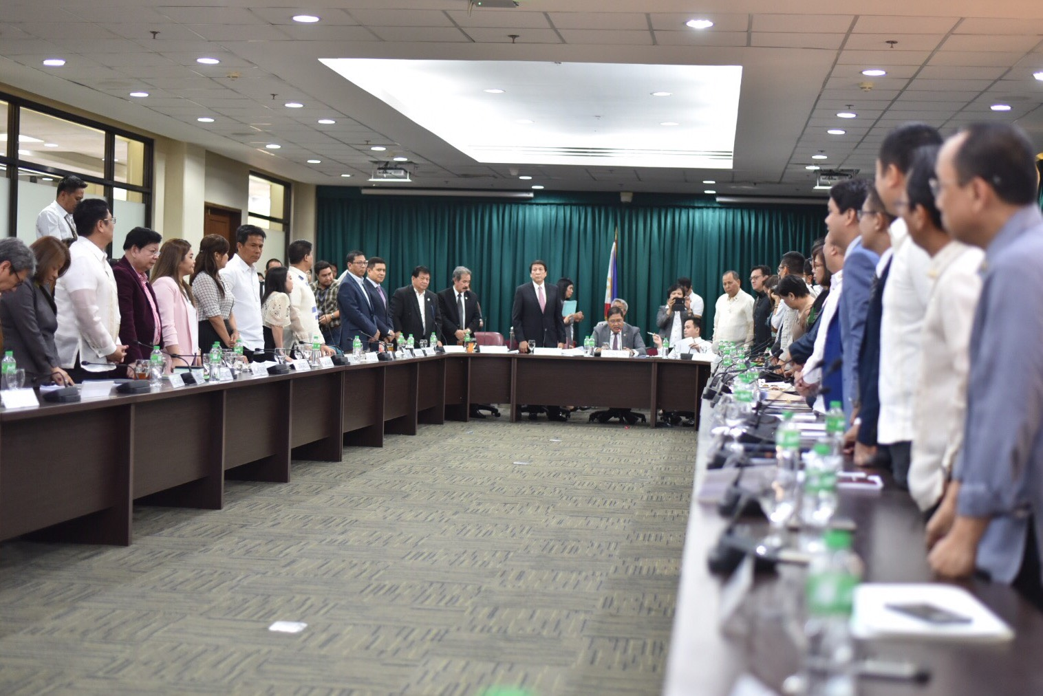 NO TO OUSTER PLOT. 42 members of the House committee on justice rise to manifest their vote rejecting the impeachment complaint against the President on May 15. Photo by LeAnne Jazul/Rappler