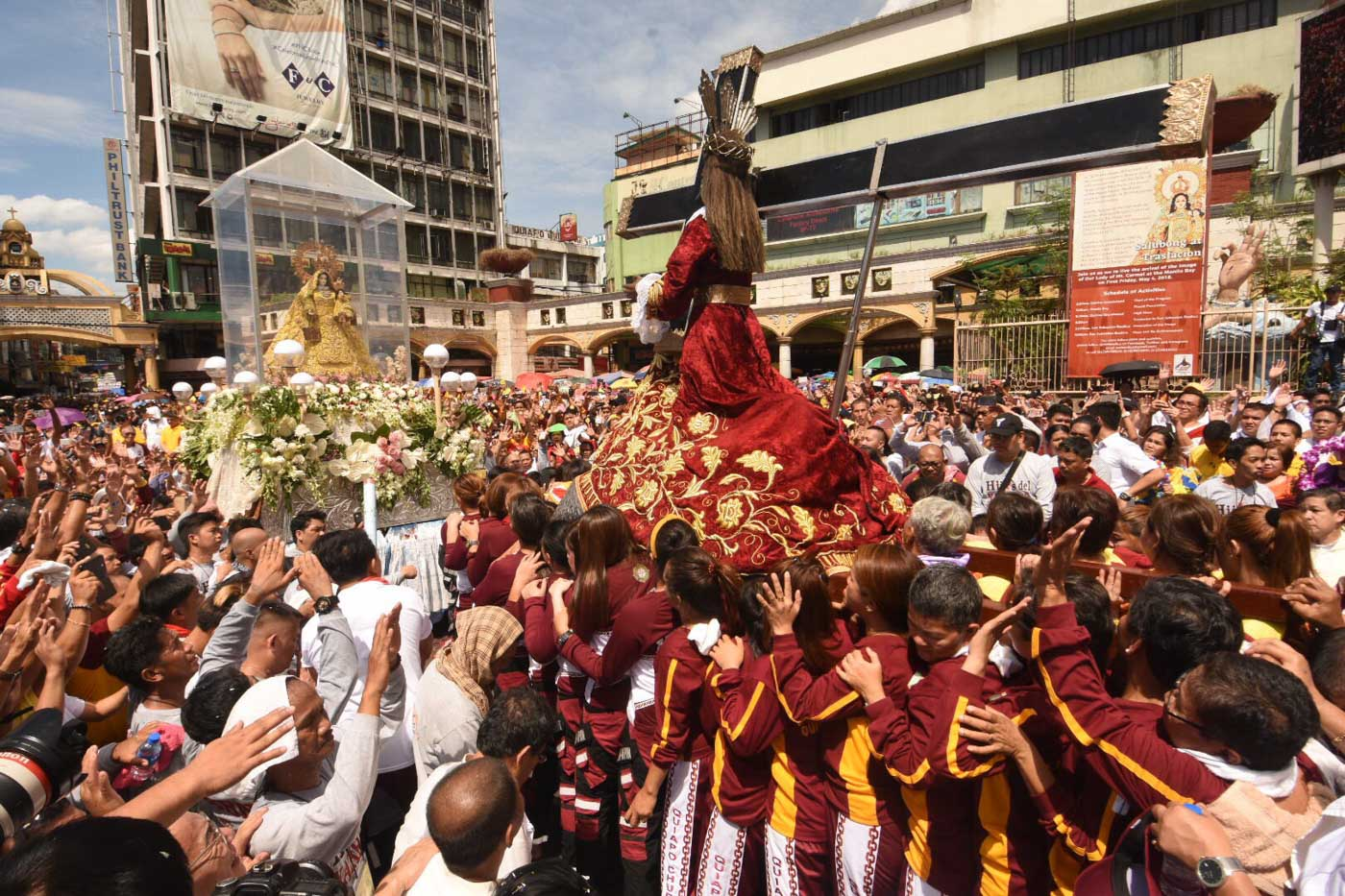 MOTHER AND SON. The image of Our Lady of Mount Carmel 'meets' the image of the Black Nazarene in front of Quiapo Church on May 4, 2018. Photo by Angie de Silva/Rappler