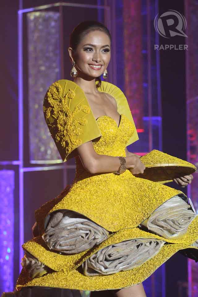 RICE INSPIRATION.  Ma Teresita Alaine Baccay in a bright yellow modern terno by Abbog Ocampo. File photo by Manman Dejeto/Rappler