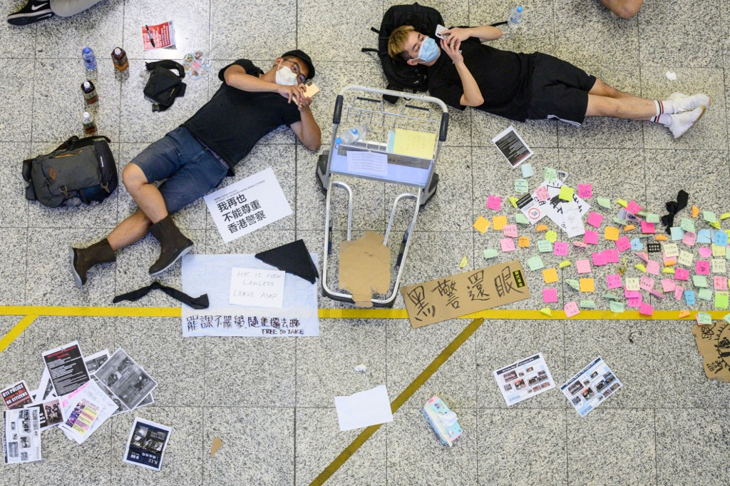 REST. Protesters rest at Hong Kong's International airport during a protest against the police brutality and the controversial extradition bill on August 12, 2019. Photo by Philip Fong/AFP