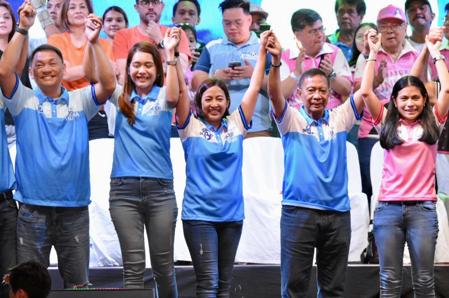 ABBY'S ALLIES. The Binays raise the hands of their candidates under the Team Performance slate.