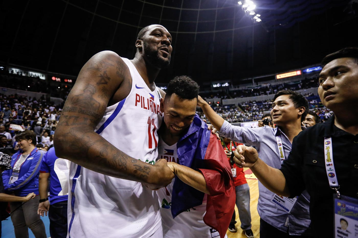 BROTHERS. Andray Blatche and Jayson Castro hug each other. Photo by Josh Albelda/Rappler