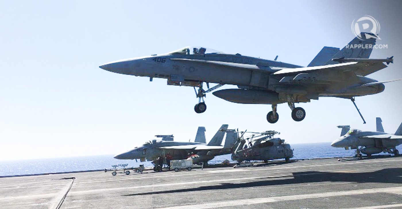 HORNET. An F-18 Hornet about to land on the flight deck of the USS Carl Vinson. Since the runway is short, the aircraft must hook (rear pointing downwards) onto arresting cables on the deck to bring it to a complete stop. Photo by Camille Elemia/Rappler