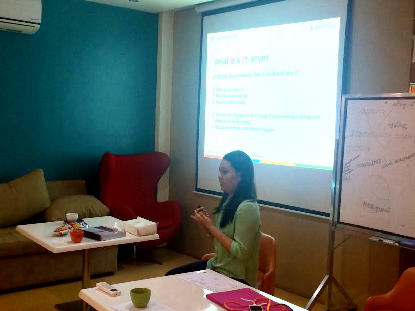TEACHING. Brenda Valerio of IdeaSpace teaching scholars about the Lean Model Canvas. Valerio serves as the Incubation Specialist for IdeaSpace and her startup won 3rd place at Startup Weekend Manila 2014.