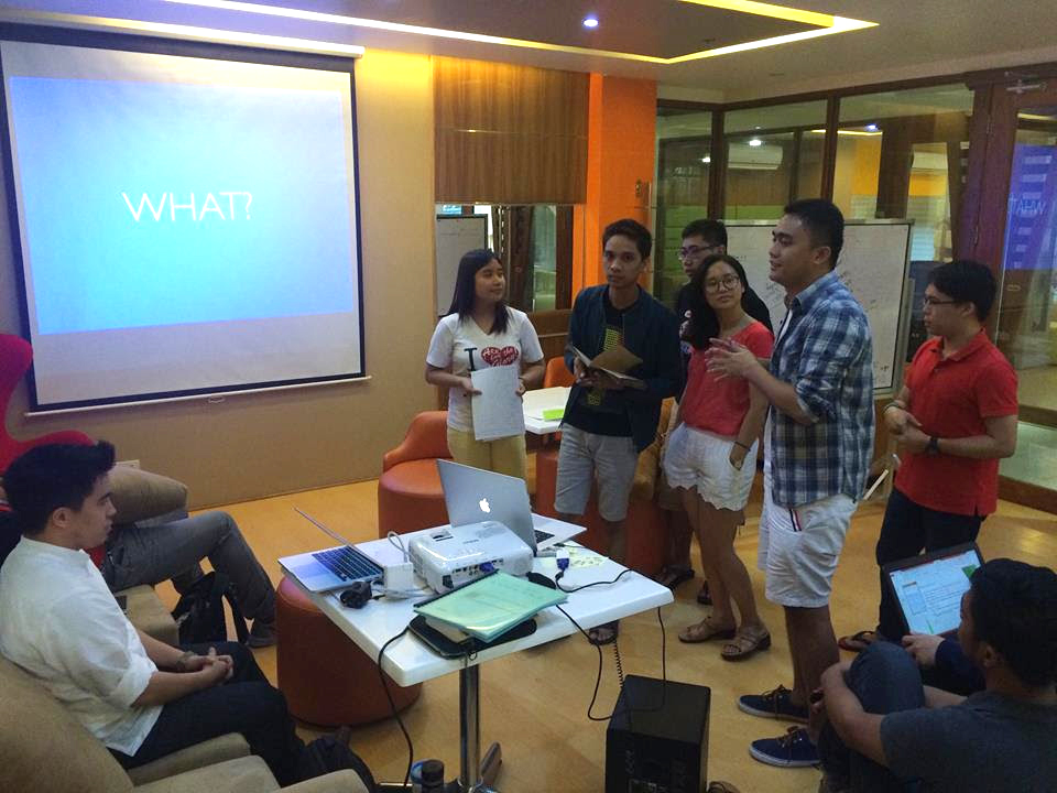 PITCHING. From left: Richard Dacalos and scholars Johna Mandac, Ryan Gersava, Carlo Cojuangco, Fran Aguilan, Raven Duran, and Ginbert Castillo. Here the scholars pitch their ideas from the exercise to guest speaker Richard Dacalos.