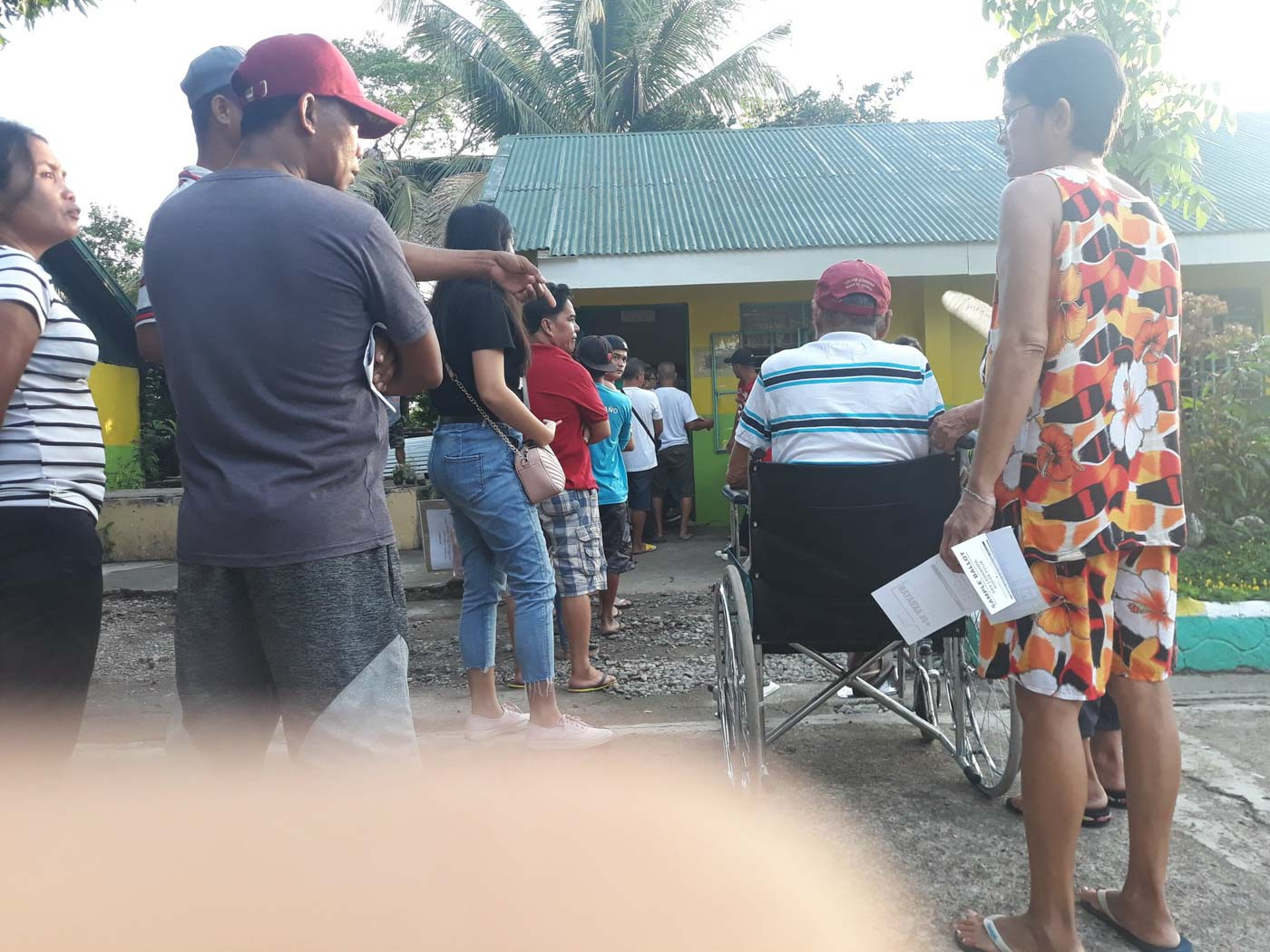 NUEVA ECIJA. PWDs and senior citizens wait in long lines to cast their votes at Nieves Elementary School in San Leonardo, Nueva Ecija. Photo by Jhon Oliver Nery/Rappler