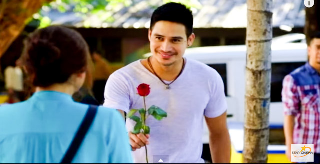 SWEET GESTURES. Gino gives Trixie a rose. Screengrab from YouTube