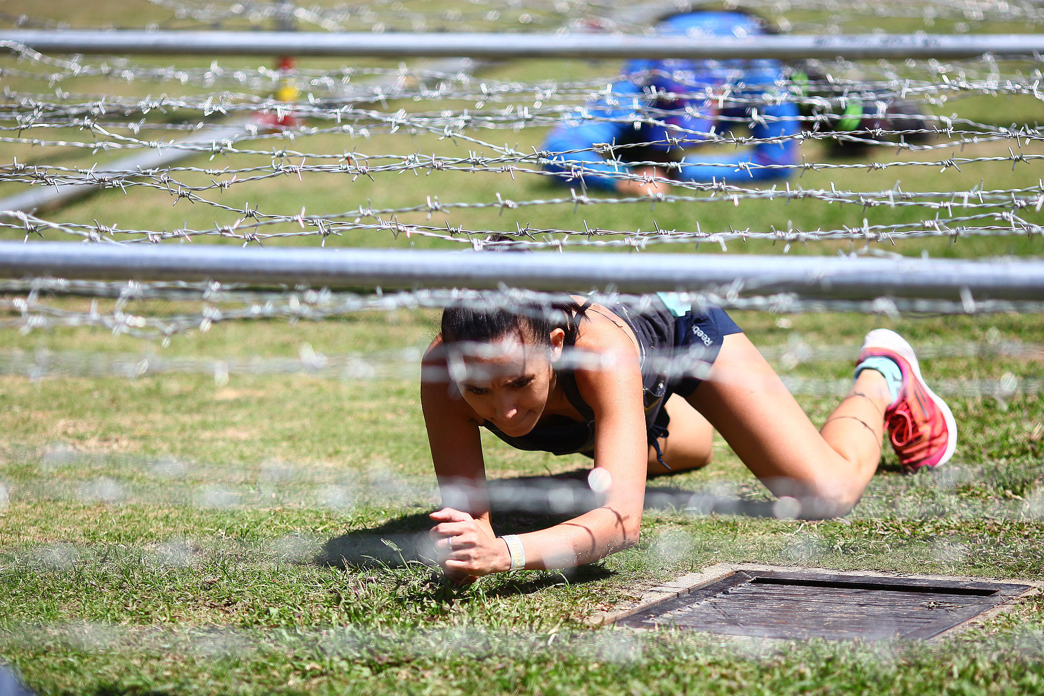 GRUELING COMPETITION. A contestant crawls under barbed wire. Photo by Josh Albelda/Rappler
