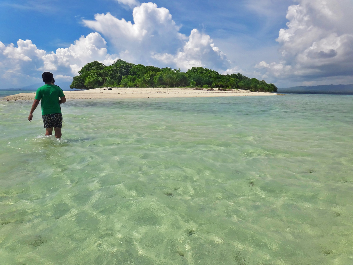 PRISTINE ISLET. Canigao is a small island rich in greenery and fringed with white sand, and in some parts, flat gray rocks. Photo by Rhea Claire Madarang