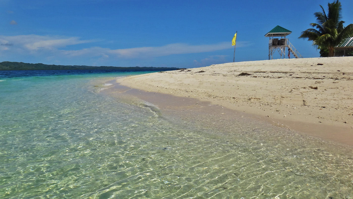 BLUES AND WHITES. On a sunny day, Canigao's clear waters reflect the skyu00e2u0080u0099s blue, and its white sand shines bright. Photo by Rhea Claire Madarang