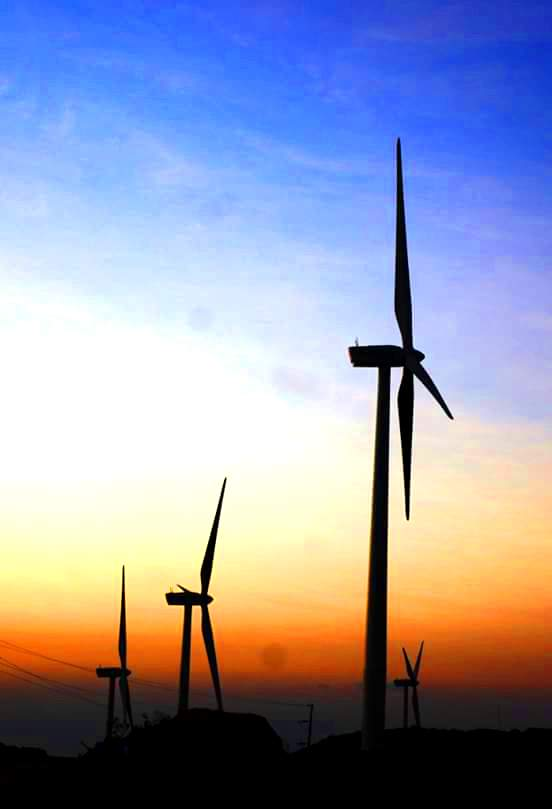 SUNSET. The windmills make a beautiful silhouette in the sky during sunset or dusk. Photo by Evy Yap