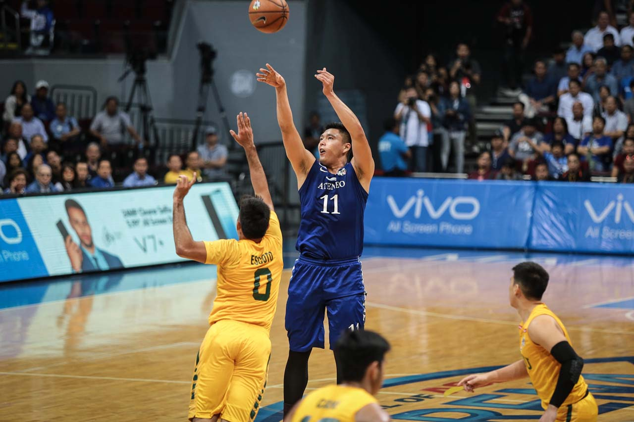 BUZZER BEATER. Isaac Go's heroics greatly help the Blue Eagles make it to the fnials. Photo by Josh Albelda