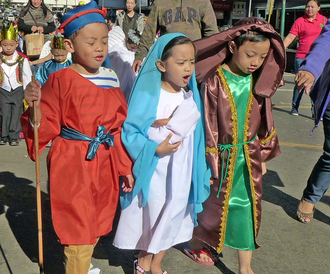 BELEN. Kids dressed up as Mary, Joseph, and one of the shepherds