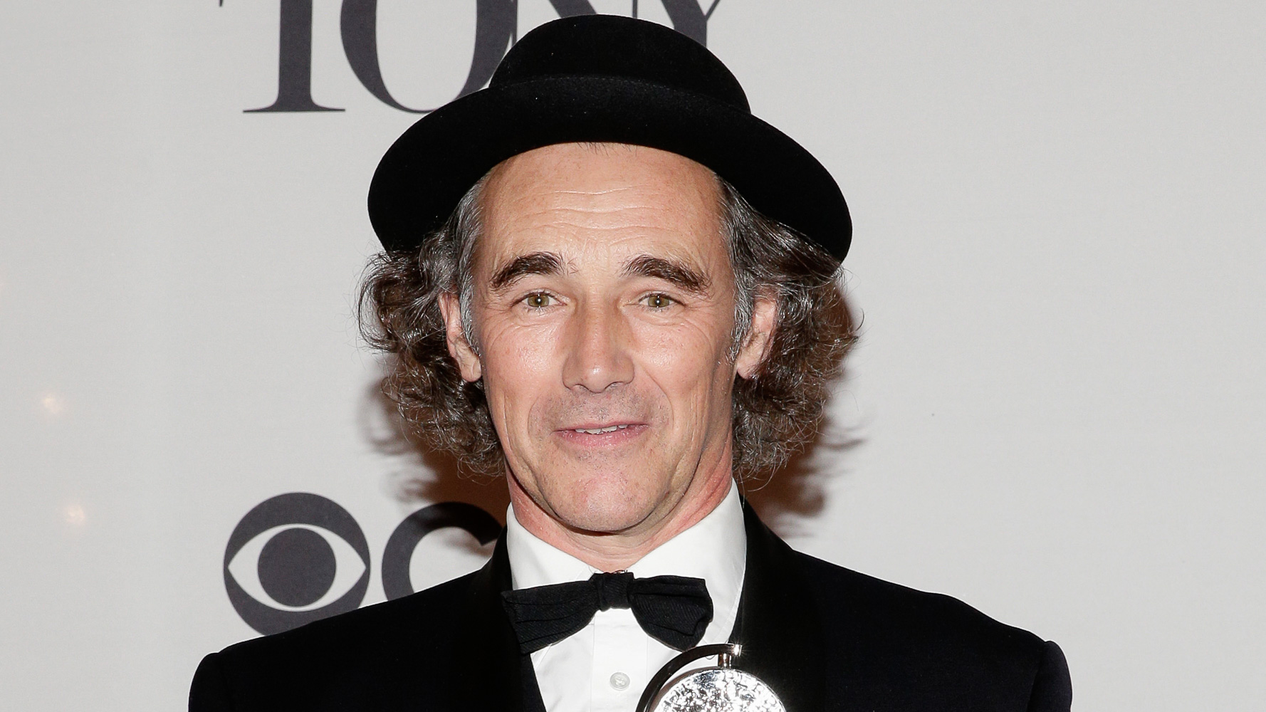 Actor Mark Rylance, of the United Kingdom, holds the Tony Award for Best Performance by an Actor in a Featured Role in a Play for his work in 'Twelfth Night' in the press room at the 2014 Tony Awards. Photo by Jason Szenes/EPA
