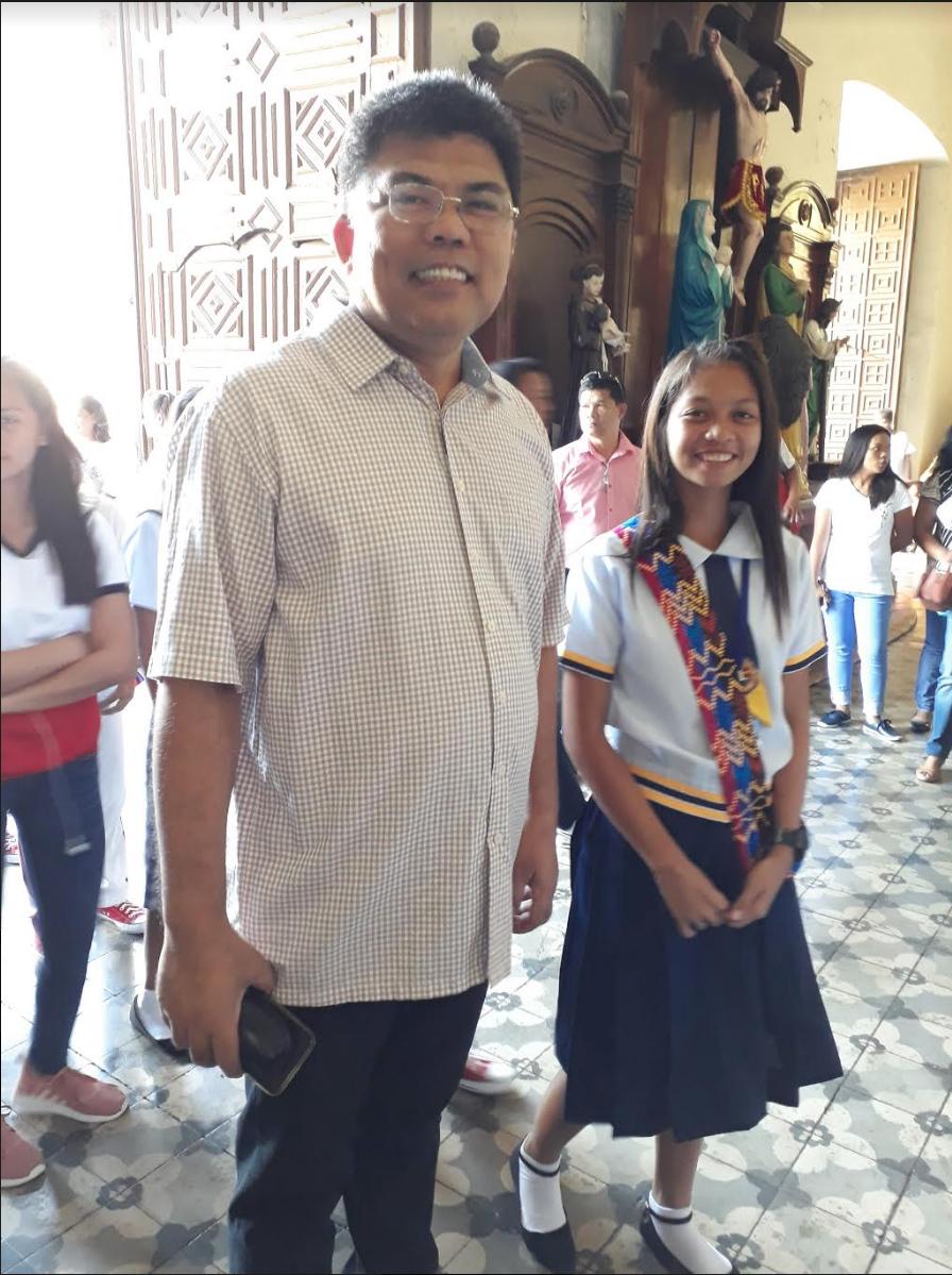 ADOPT-A-GRADUATE. Giovanni Velasco, chief of Vigan school govevernance division, is seen here with a Zamboangueu00f1o graduate he u0022adopted.u0022 Photo by Editha Bagcal