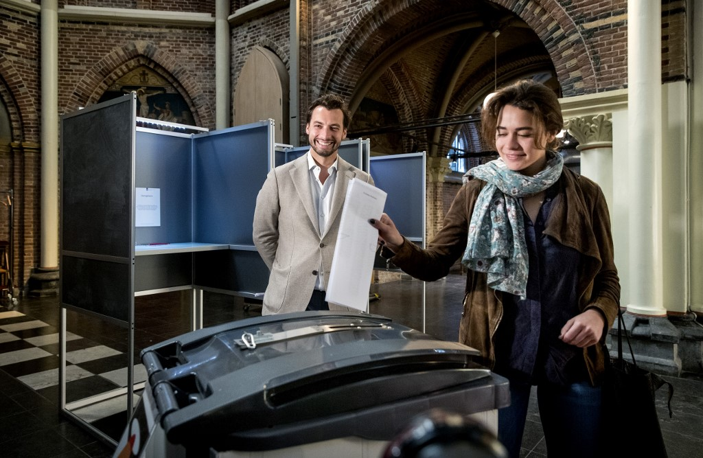 THIERRY BAUDET. Netherlands far-right party Forum for Democracy (FvD) leader Thierry Baudet watches his fiancee Davide Heijmans casting her ballot for the European elections at a polling station at the Posthoornkerk basilica in Amsterdam on May 23, 2019. Photo by Koen van Weel/ANP/AFP