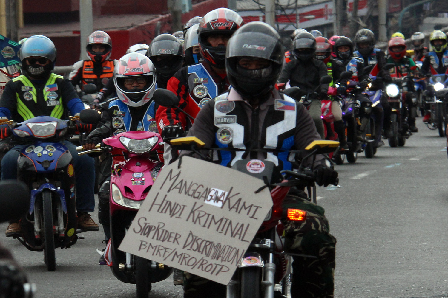 'WORKERS NOT CRIMINALS.' Riders unite along EDSA in December 2018 to protest the Motorcycle Crime Prevention Act's passage. Photo by Darren Langit/Rappler