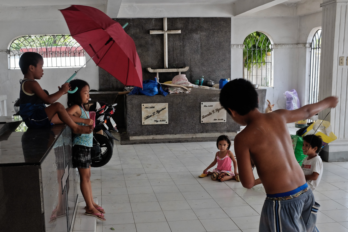 NOWHERE TO GO. Families from 'Purok Kawawa' in Barangay San Jose District III, have turned the public cemetery into an evacuation center.