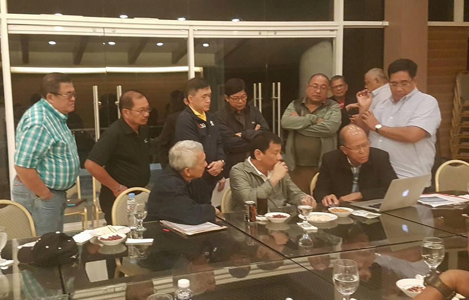 SURVEILLANCE. President Rodrigo Duterte is shown photos of the Chinese vessels near the Scarborough Shoal. Photo posted by Agriculture Secretary Manny Piu00f1ol on Facebook