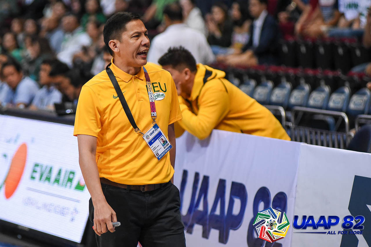 GOOD JOB. 'Iu2019m just happy with the way we responded today especially coming off that loss to Ateneo,' says FEU coach Olsen Racela. Photo release