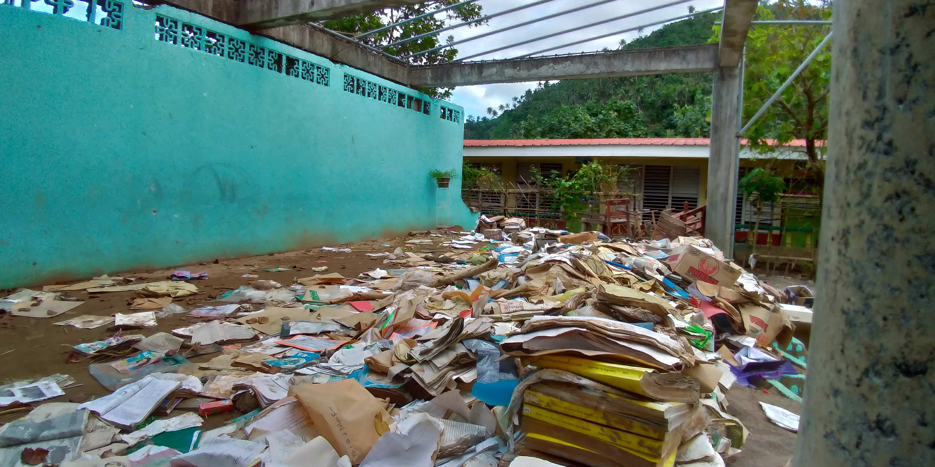 DESTROYED BOOKS. The school is waiting for replacements from the Department of Education. Photo by Mavic Conde/Rappler