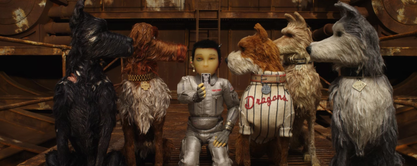 WES ANDERSON. With its cute-as-a-button visual appeal and humorous charm, it isnu2019t very hard to fall head-over-heels in love with Isle of Dogs. All stills from the official movie trailer