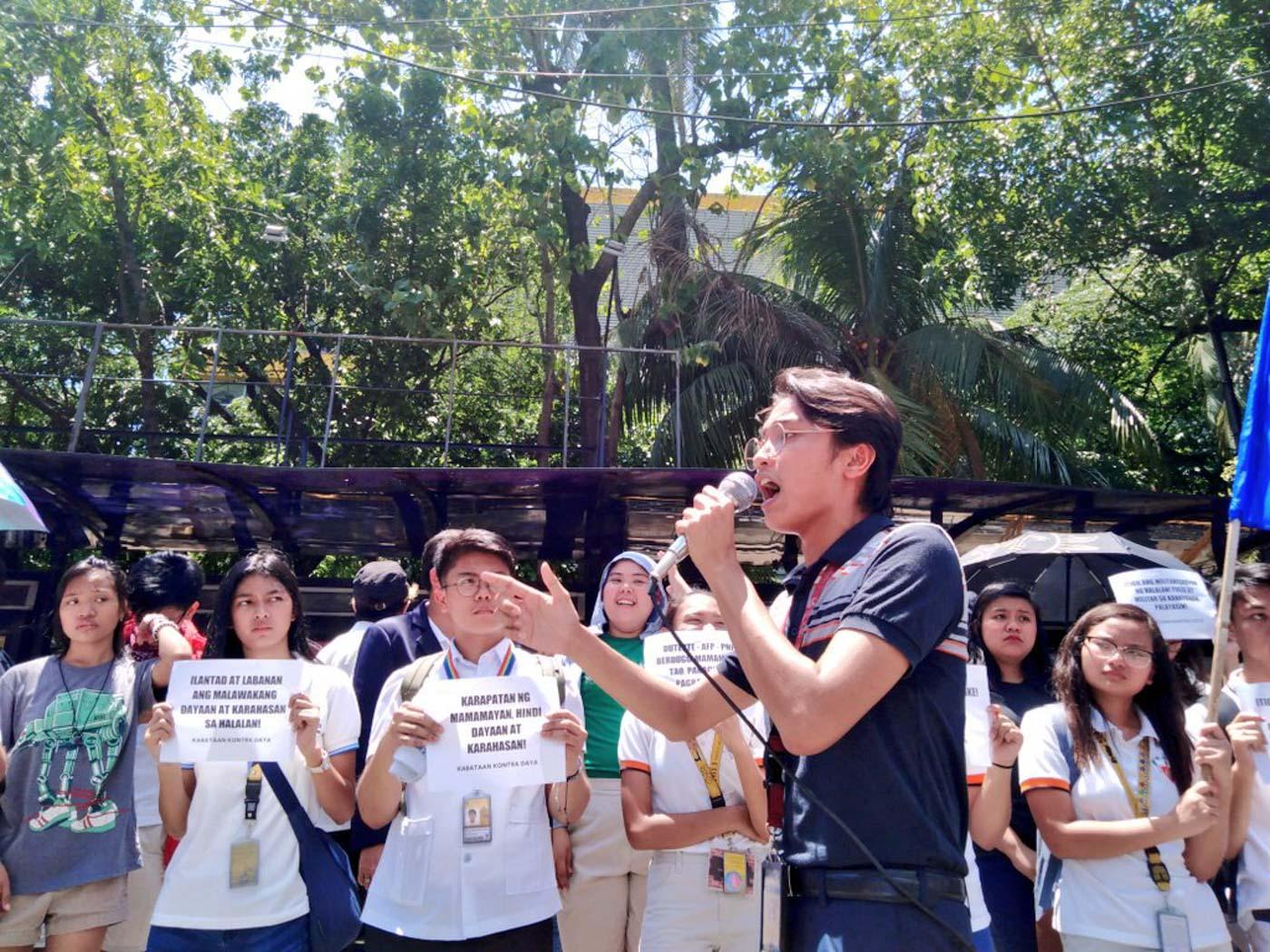 UST. Panday Sining's Angelo del Rosario speaks before protesters at the University of Santo Tomas in Manila. Photo by Jomar Villanueva/Rappler