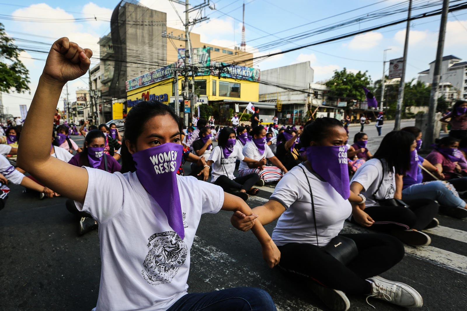 BLOCKING STREETS TO FIGHT FOR RIGHTS. The theme of the protest u0022women occupy spaceu0022 the symbolic action aims to raise the call to block the passge of the anti terrorism bill or EO 70 in the Senate. Photo by Jire Carreon/Rappler