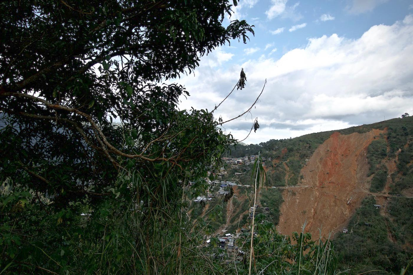 LANDMARK. The collapsed soil turns an entire section of the Itogon mountainside bare. Photo by Rambo Talabong/Rappler