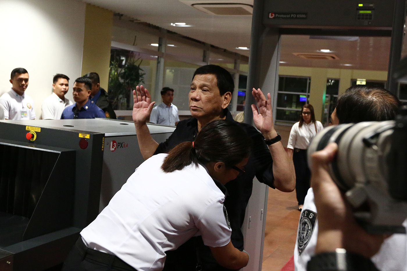 SECURITY CHECK. President Rodrigo Duterte submits himself for security inspection upon his arrival at the Bohol-Panglao International Airport for its inauguration on November 27, 2018. Malacau00f1ang photo