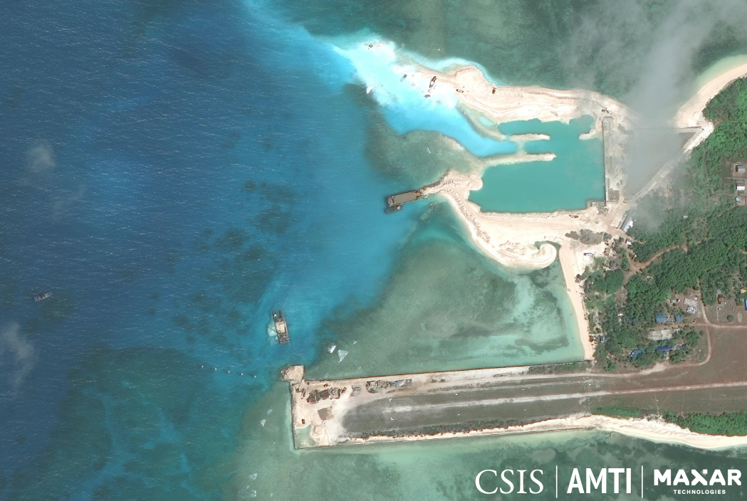 SLOWLY BUT SURELY. This satellite image from February 2020 shows significant progress in the repairs on Pag-asa's runway, and on the construction of a beaching ramp and a harbor nearby. Photo from AMTI-CSIS