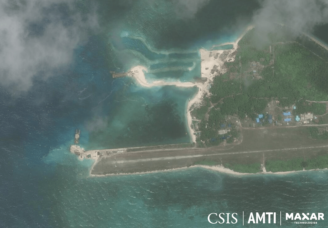DREDGING. This image from June 2019 shows two barges doing dredging work on Pag-asa Island. One is repairing a sunken portion of the airstrip, while the other appears to be building a beaching ramp. Photo from AMTI-CSIS