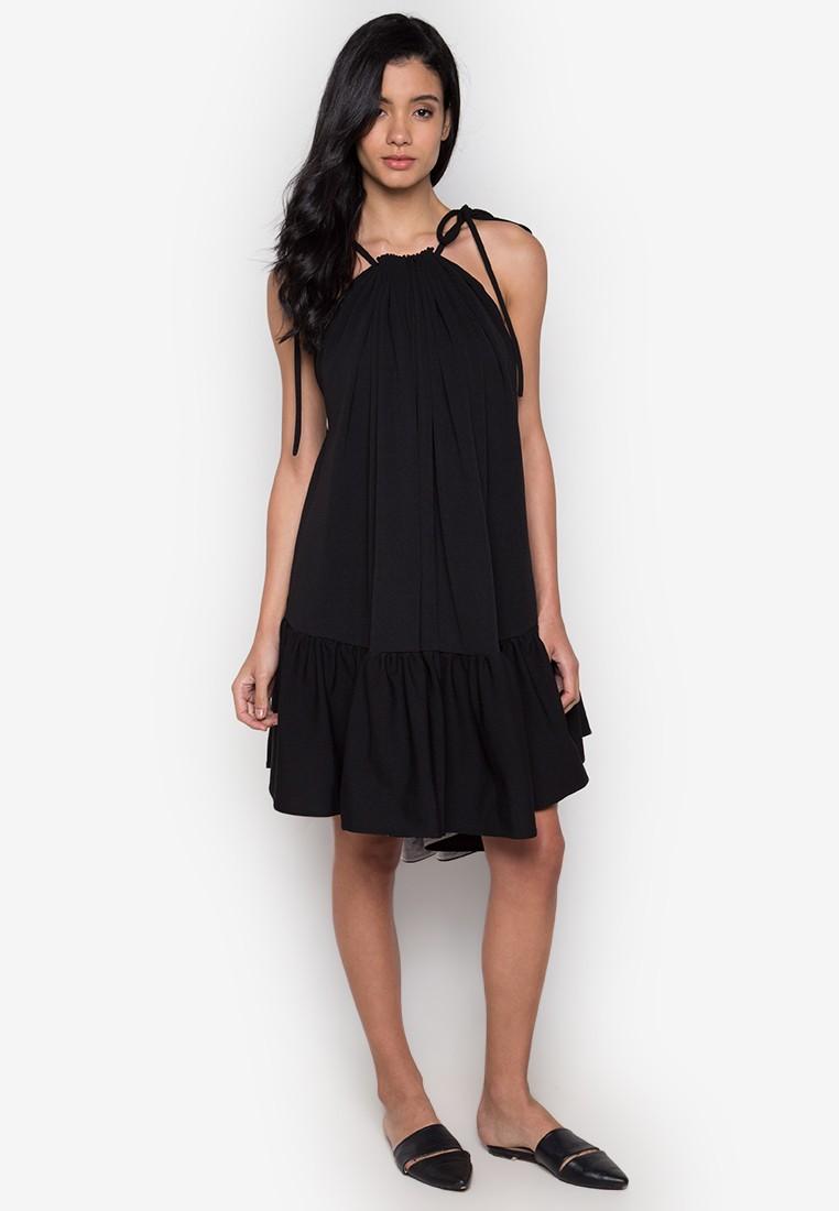 Black halter neck dress by Rhett Eala