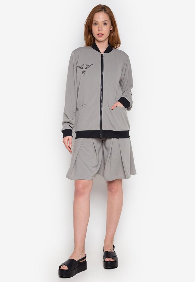 Gray bomber jacket on gray pleated shorts by John Herrera