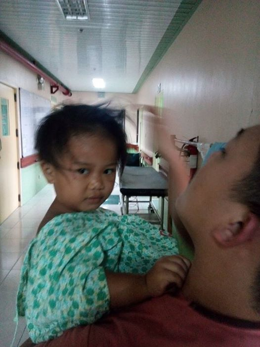 UNIDENTIFIED. A hospital worker attends to a child survivor of a bus crash that killed nearly 30 people in Nueva Ecija. Photo from Veterans Regional Hospital of Nueva Vizcaya
