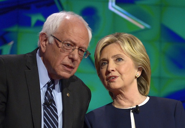 DEAD HEAT. In this file photo, US Democratic Presidential candidates Bernie Sanders (L) and Hillary Clinton (R) talk to each other on stage prior to the start of the Democratic presidential candidates debate at Wynn Las Vegas in Las Vegas, Nevada, USA, October 13, 2015. Mike Nelson/EPA