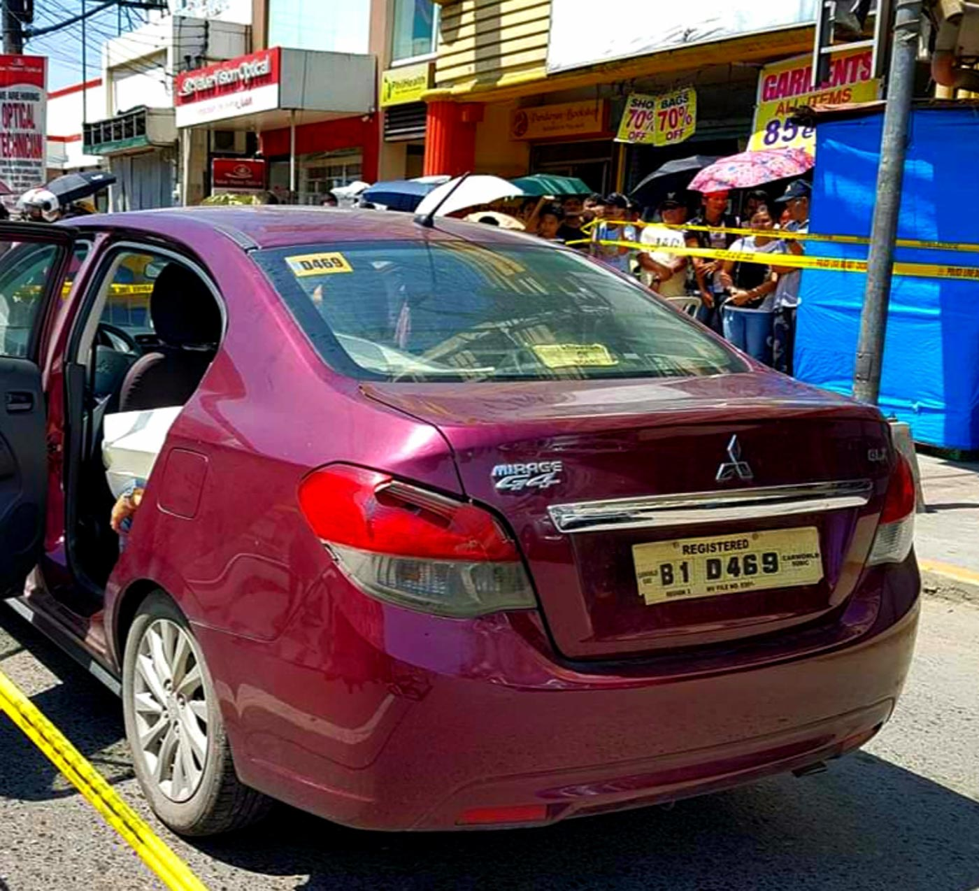 SURVIVOR. A one-year-old child survives the attack inside the car. Photo courtesy of Olongapo City police