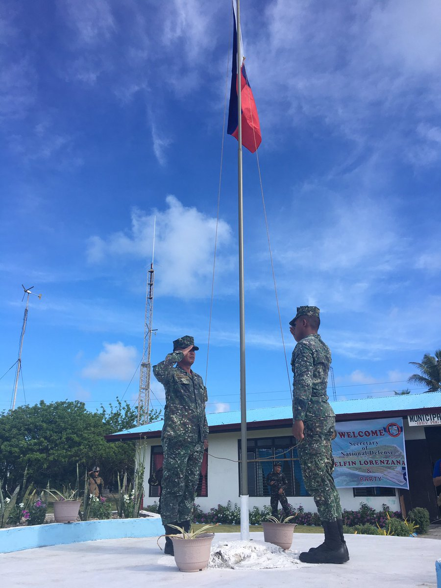 FLAG-RAISING. A flag-raising ceremony is held upon the arrival of Philippine officials in Pag-asa. Photo by Carmela Fonbuena/Rappler
