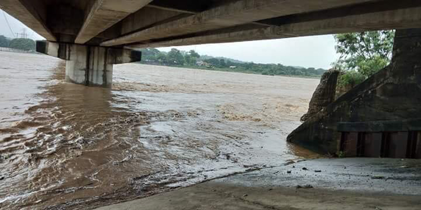 WATER LEVEL. The water level under the Bacarra Bridge rises due to continuous rainfall in the region. Photo from Bacarra municipal government
