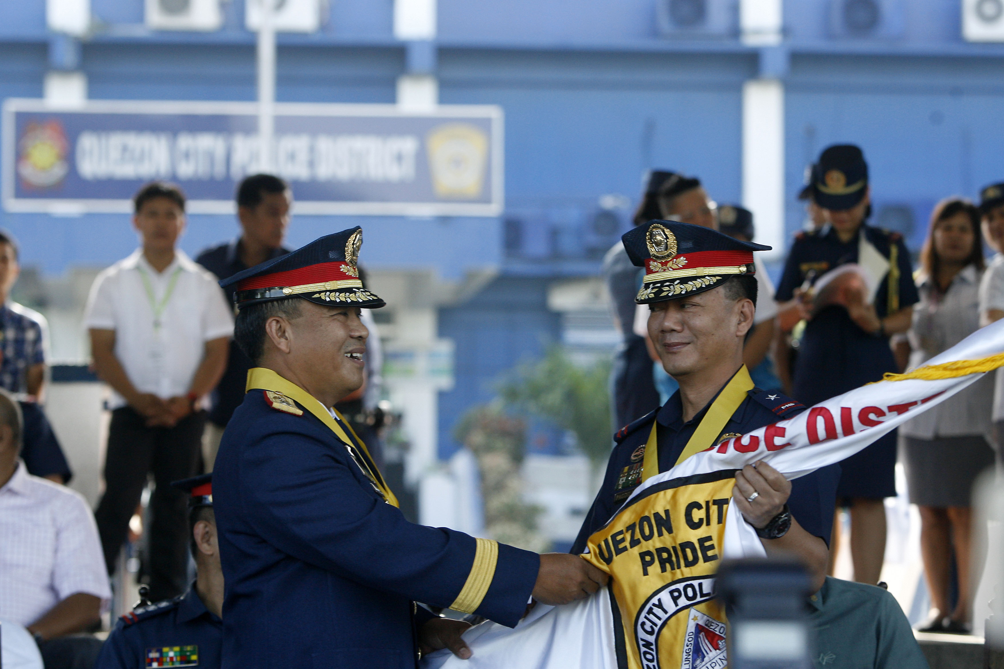 DENIALS. In this file photo, Quezon City Police District director PCSupt. Edgardo Tinio (left) accepts the command flag from NCRPO and outgoing QCPD director PCSupt. Joel Pagdilao on July 30, 2015. File photo by Ben Nabong/Rappler