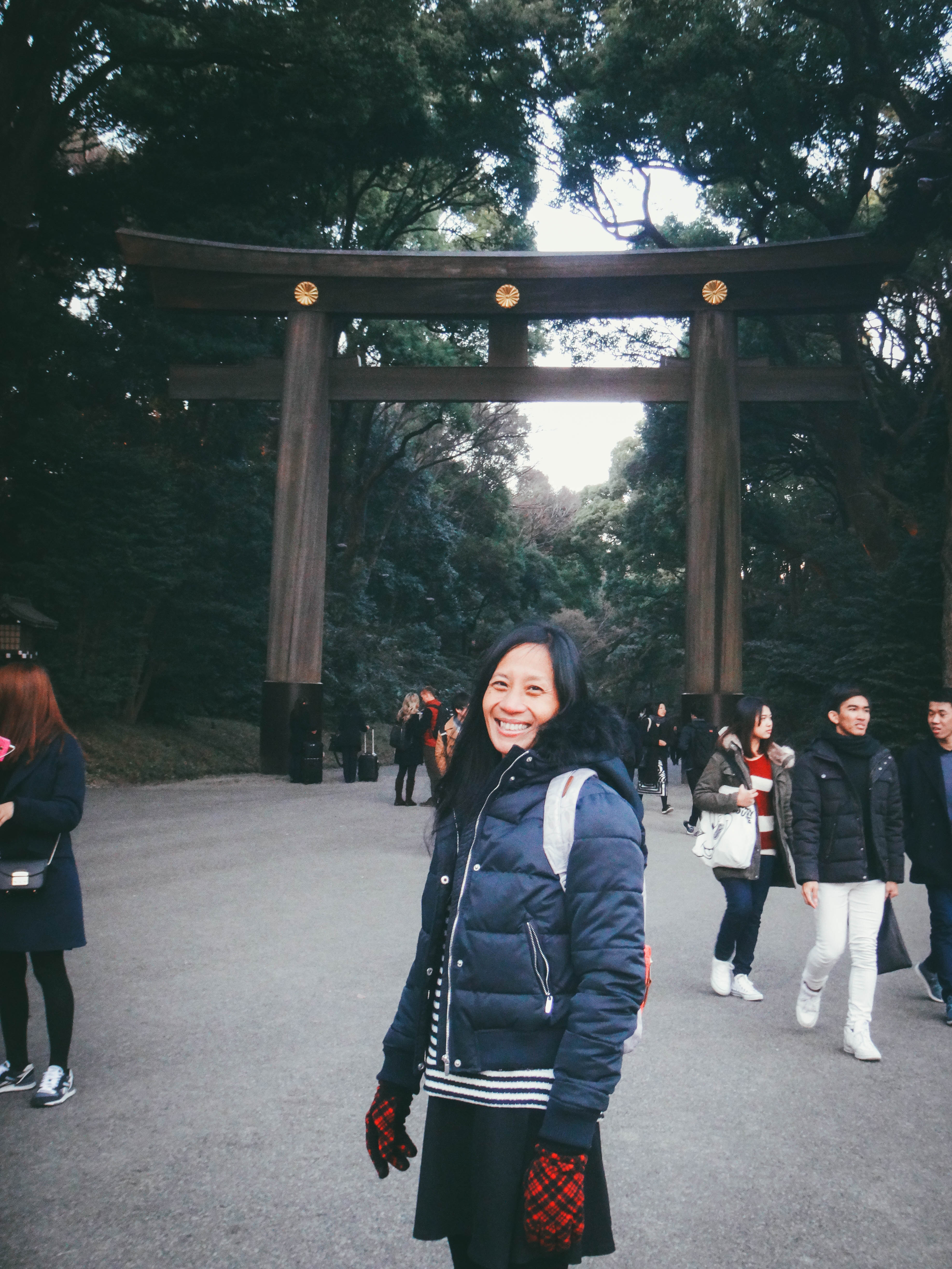 MEIJI SHRINE. The author's mother poses in front of the Meiji Shrine's torii gate, a fixture found in Shinto shrines. Photo provided by Irene Maligat