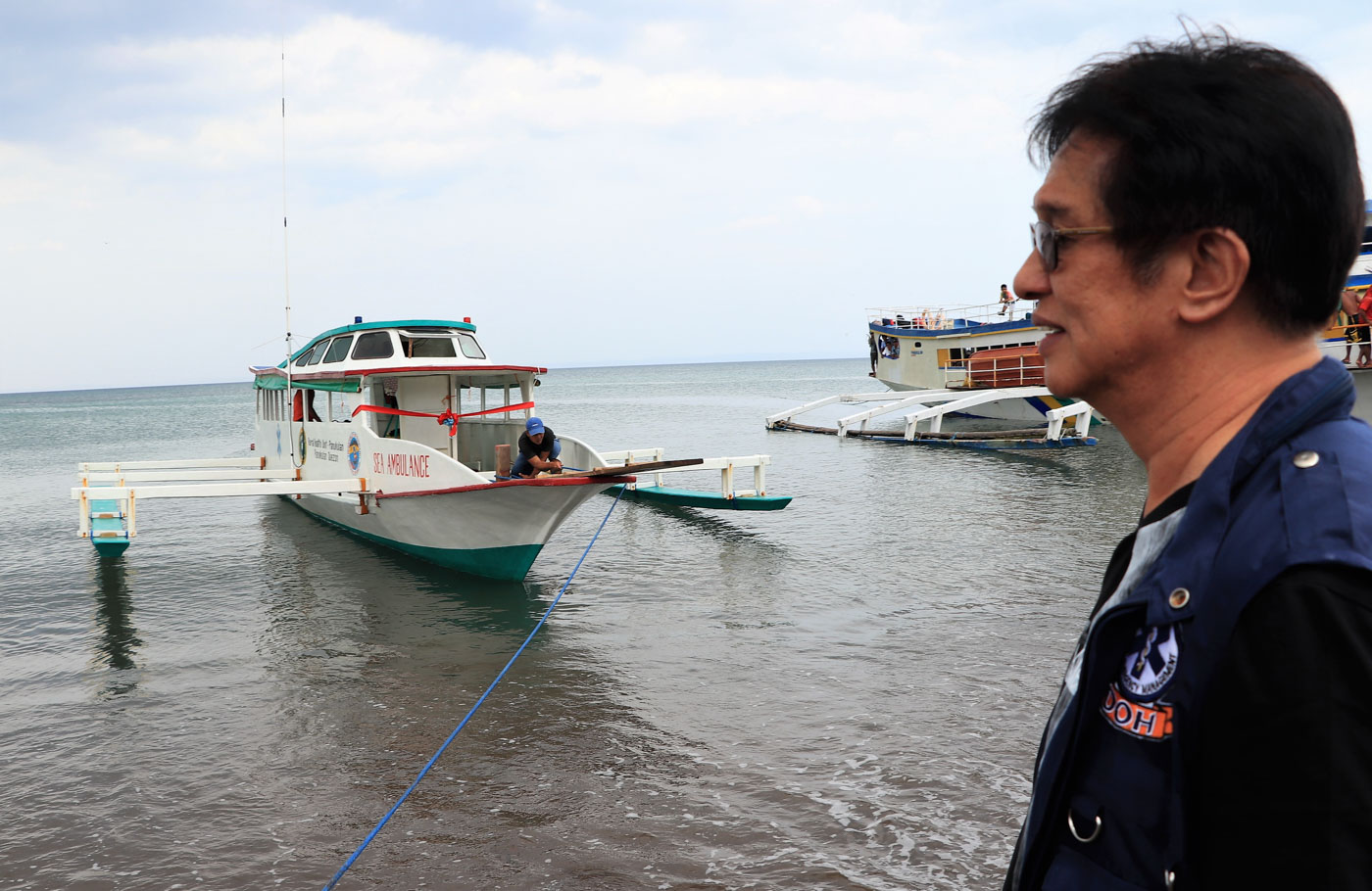DREAM FULFILLED. Another dream fulfilled for DOH-CALABARZON Regional Director Eduardo C. Janairo who is instrumental in the accomplishment of the project as he gazes to the emergency vessel. Photo courtesy of DOH-CALABARZON