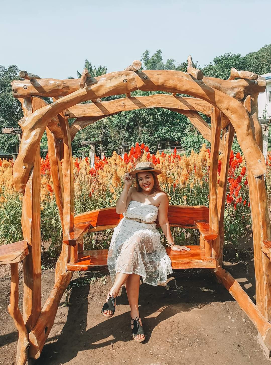 RELAXING. This wooden swing is great for relaxing and taking photos. Photo courtesy of Andrelyn Garan