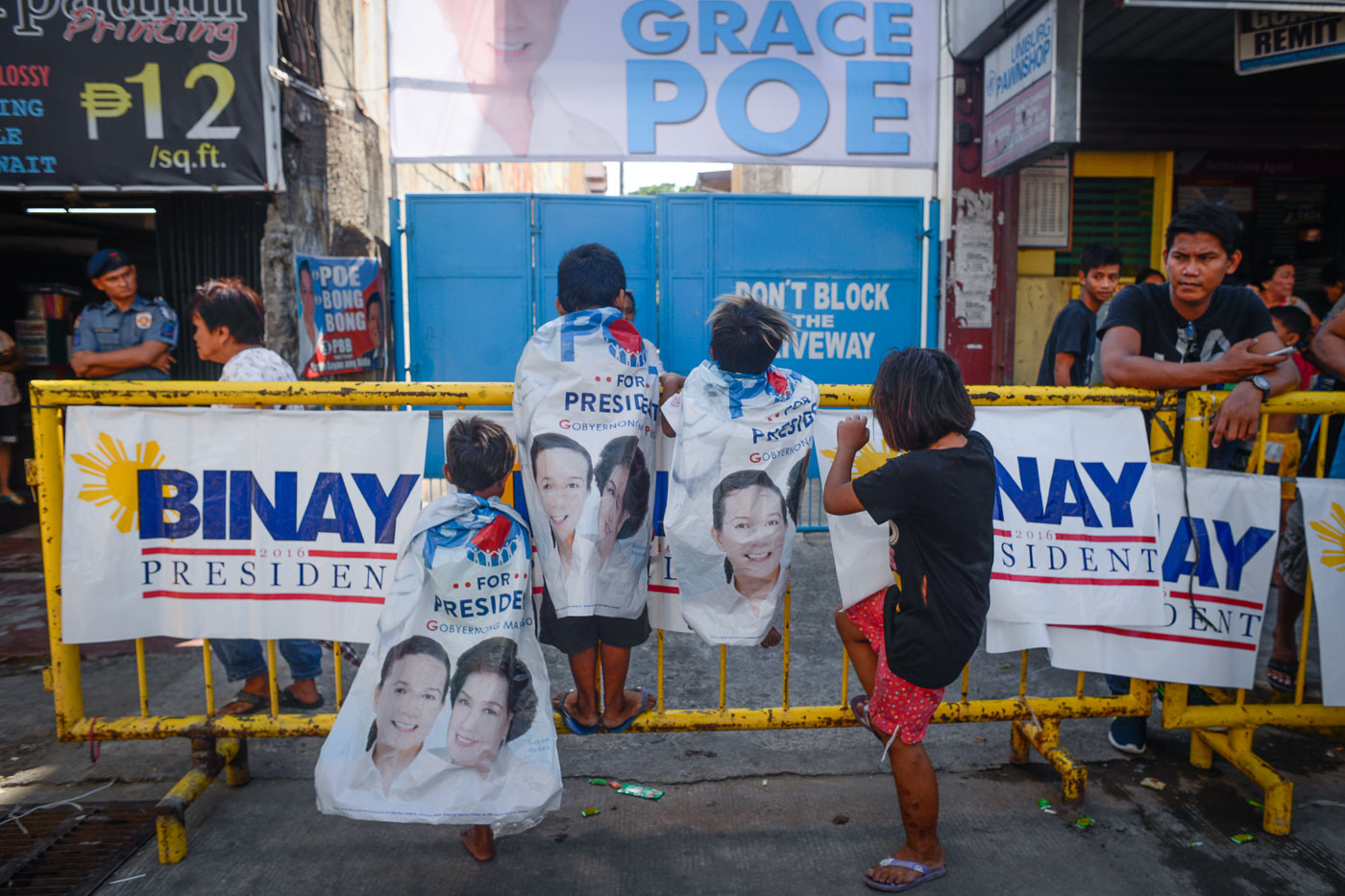 PLAYTIME. Children play with campaign materials that can be found almost everywhere in Dagupan City. All photos by LeAnne Jazul/Rappler