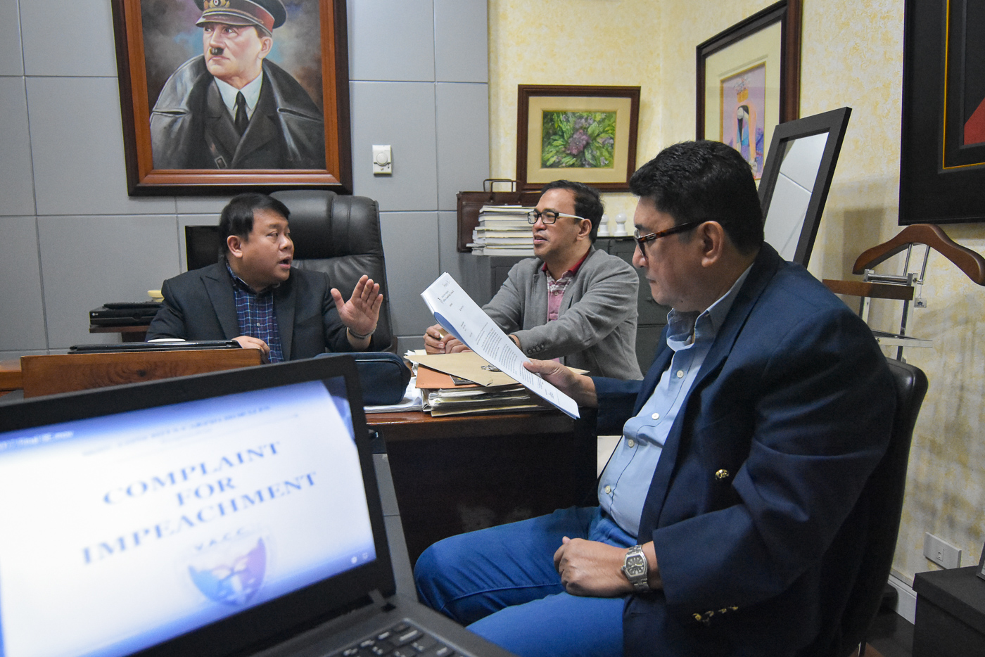 COMPLAINT VS OMBUDSMAN. Ferdinand Topacio, Manny Luna and Jing Paras in a huddle inside the Topacio Law office on October 27, 2017, on the impeachment complaint by the VACC against Ombudsman Conchita Carpio-Morales. Photo by LeAnne Jazul/Rappler